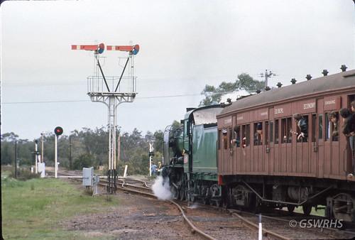 7909E-16