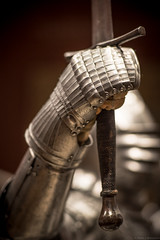To Victory! (Fret Spider) Tags: canonfd85mmf12sscaspherical manuallens armor arms medieval knight museum gallery gauntlet sword helmet bokeh bokehdelicious vintage classic history hero oof dof depthoffield outoffocus victory defeat honor integrity