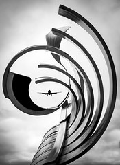 Flight 007 (abso847) Tags: black white airplane tennessee chattanooga lines sculpture art district steel bw clouds creative