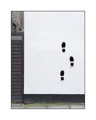 Street Art (Unknown Artist), North London, England. (Joseph O'Malley64) Tags: streetart streetartist urbanart publicart freeart graffiti northlondon london england uk britain british greatbritain art artist artistry artwork stencils stencilwork render blockwork stoneblocks brickwork bricksmortar cement pointing woodenpicketspikes woodenfencingpanel pavement algae weeds victorianbuilding victorianstructure urban urbanlandscape aerosol cans spray paint fujix x100t accuracyprecision