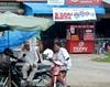 Talking About Money (mikecogh) Tags: cambodia village men motorbikes sign money moneychanger umbrella