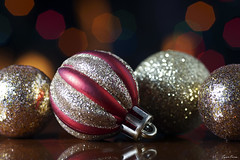 Festive (Tyson J) Tags: select festive christmas holiday red gold glitter reflection fire bokeh lights colors cheer season ornament ball round sony tyson