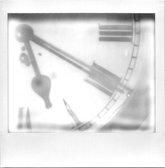 Fading Time (Rational_Photography) Tags: polaroid theimpossibleproject impossible project retro vintage antique analogue analog hipster film photo picture spectra image se sun autofocus slr jobpro montreal quebec canada originals 80 90 self developing instant expired fade fading clock hand black white time roman numbers numerals face paint old metal glass close up closeup attachement light natural death dad father 5 20 520 five twenty