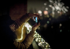 Recording The Fireworks (natures-pencil) Tags: fireworks newyear night balcony smartphone people recording video
