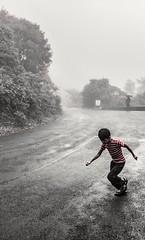 Rain rain go away....!!! (vikramgopinath) Tags: child rain monsoon thunder happy nature monochrome red casual umbrella