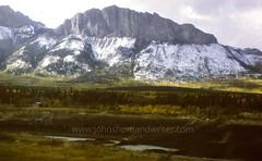 Snow Line (john shortland) Tags: rocky mountain foothills snow canada fall autumn aspen river crag train hut forest creek alberta bowriver