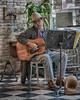 _DSC2497 Deli Cowboy Musician (Charles Bonham) Tags: musician singer guitar baycitymi cowboy cowboyhat jeans bandanna tile musicstand sonya7rll sonyfe2890mmmacrogoss charlesbonhamphotography nik hss