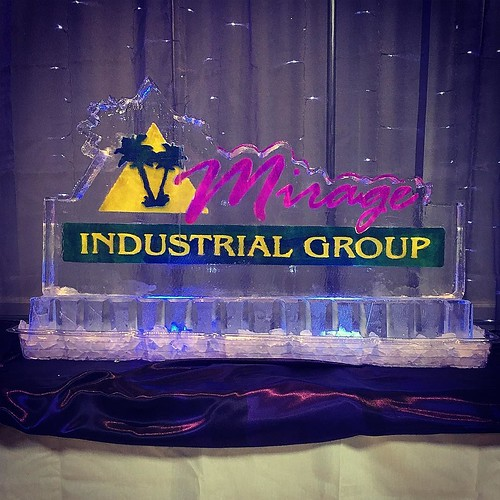 A colorful #holidayparty in #ednatx with #mirageindustrialgroup #fullspectrumice #logo #icesculpture #branding #thinkoutsidetheblocks #brrriliant - Full Spectrum Ice Sculpture