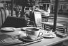 Anyone for costa- (MartinHots) Tags: nikon day costa lunch blackandwhite monochrone coffee shop restaurant newspaper cup phone
