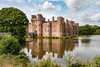 Herstmonceux Castle (Keith in Exeter) Tags: herstmonceux castle moat sussex brick wall fort fortress tower bridge gateway water tree reflection mast flag flagpole window outdoor building architecture