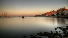 muscat seafront sunset (mariusz kluzniak) Tags: mariusz kluzniak middleeast oman muscat capital seafront port crane sunset long exposure