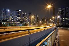 Jan 01, 2018 (pavelkhurlapov) Tags: hunghom tungsten cityscape sunstars buildings overpass walkway lights longexposure city night sky road curve lampposts