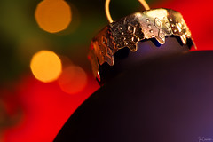 Ornament with Bokeh (iecharleton) Tags: macromondays memberschoicebokeh bokeh christmas ornament holiday winter indoors warm red green blue gold merrychristmas