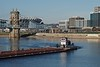 Pushboat turning on the Ohio River (durand clark) Tags: roeblingsuspensionbridge ohioriver marathonoil pushboatandbarge covington barge olympusem1