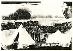 Black and White Photograph of Soldiers, Tents and Trucks at Fort Lytton, Brisbane (Queensland State Archives) Tags: brisbane fortlytton military encampment queensland historicbuildings tents trucks soldiers lytton