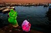 Women praying on the river Ganges at sunset - Varanasi (Roberto Farina Travel Photography) Tags: ganges river water hinduism religion woman candid reallights robertofarina sunset india asia people