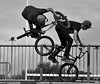 Riders in the Park (Joehii) Tags: red bmx bicycle jump tricks trick bike skatepark england wakefield cyclists black white move moving jumping riding wheels stunts street photography art skill