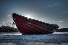 Glass fiber in ice (mvnfotos) Tags: d7000 ice red rowingboat winter
