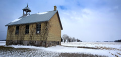 Cold Winds Blowing (Anthony Mark Images) Tags: cornfield winter winterscene cold freezing coldwinds farmfield rural snow nakedtrees decay oldabandonedchurch stonechurch brokenwindows bluesky cloudy hensal ontario canada vines yellowbrick boardedup weathervane chimney chilling stark