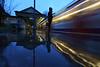 Waiting for trains - beautiful light (Luke Agbaimoni (last rounds)) Tags: london londonunderground londontube reflection reflect silhouette silhouettes lighttrails blue hour mirror southkensington kensington station train transportforlondon trains rain rainy