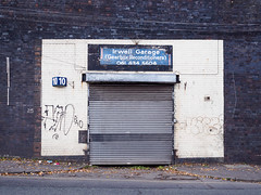 Irwell Garage (Peter.Bartlett) Tags: manchester olympusomdem5 unitedkingdom garage city doorway colour peterbartlett shutter urban uk m43 microfourthirds wall urbanarte sign lunaphoto facade door england gb