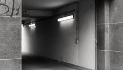 Huyssenallee (frankdorgathen) Tags: huyssenallee essen ruhrgebiet town urban city passage door wall light electricity monochrome blackandwhite banal banality