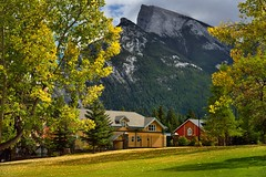 Greens, Yellows and a Little Bit of Red (thor_mark ) Tags: nikond800e lookingse day2 triptoalbertaandbritishcolumbia banff capturenx2edited colorefexpro grassylawn buildings mountrundle rockymountains canadianrockies southerncontinentalranges southbanffranges rundlepeaks trees cascadegardens outside nature landscape blueskieswithclouds mountains mountainsindistance mountainsoffindistance hillsideoftrees evergreens mountainside colorofleaves coloroftrees leafcolors autumnleafcolors colorfulbuildingsides portfolio project365 alberta canada