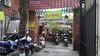 Secret restaurant (Roving I) Tags: restaurants dining vietnamesecuisine motorcycles gates entrances signs danang vietnam