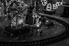 Miniature Christmas Fair - Black and White (LachMH) Tags: canon 700d rebel t5i 1855mm lens long exposure lights christmas night nighttime holidays canberra cbr gordon model railway track miniature people ferris wheel santas workshop black white monochrome