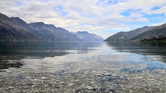 Landscapes of Kingston, South Island (3) (geemuses) Tags: kingston queenstown southisland newzealand scenic scenery landscape landscapes water mountains freshwater blue green nature people picturesque reflections reflection rock stones sky lakewakatipu eyremountains hectorrange