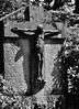 Auf dem Friedhof der kleinen Kapelle in Wense / At the grave yard of the small chapel in Wense (1) (Lichtabfall) Tags: sw bw einfarbig blackwhite blackandwhite monochrome schwarzweiss cross kreuz jesus grab grave wense grabstein gravestone friedhof graveyard christus christ