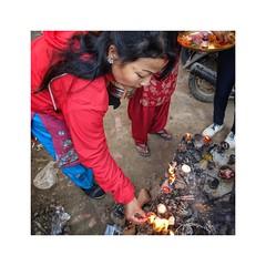 Lighting a candle (posterboy2007) Tags: candle kathmandu nepal hindu festival woman red street sony