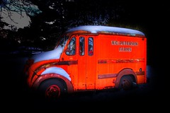 Some people wish for a Porsche; some want a Lamborghini; while others crave a Ferrari. Me? I want this vintage A.C. Petersen's milk truck. (Fotofricassee) Tags: 1950s antique old vintage glows orange truck milktruck