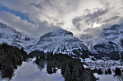 Beneath Giants (Rudi Verspoor) Tags: switzerland clouds blue sky mountains mountainscape hiking skiing walking europe snow white alpine nature landscape