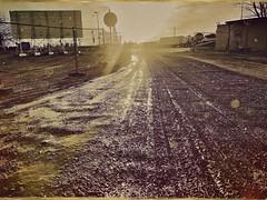 Schlammromantik (Casey Hugelfink) Tags: munich münchen langwied mud schlamm baz tracks spuren sunset sonnenuntergang wasteland fence zaun bauzaun nirgendwo nowhereland