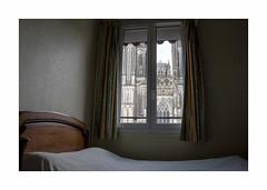 Room 16 (with view) (hélène chantemerle) Tags: hôtel chambre lit fenêtre rideaux cathédrale intérieur hotel room bed windows cathedral indoor normandy coutances