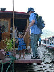 Young Deckhand (Toats Master) Tags: laos mekongriver river longboat water plants nature blooms