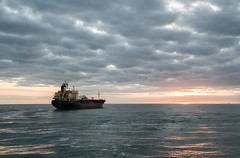 Into the Setting Sun (hp181san) Tags: sonyalpha sonya7r2 pilotage pilot texas galveston landscape seascape availablelight tanker nautical maritime sunset blue clouds ship