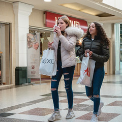 Friends (Howie Mudge LRPS BPE1*) Tags: girl girls friends arcade mall shops window floor inside indoors candid casual portrait people photo photograph photographer photography aylesbury england uk street streetphotography streetlife streetstyle square squareformat color colour
