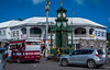2017 - Regent Cruise - St. Kitts - Berkley Memorial Clock (Ted's photos - For Me & You) Tags: 2017 cropped nikon nikond750 nikonfx regentcruise tedmcgrath tedsphotos vignetting basseterre stkitts basseterrestkitts clocktower clock basseterreclocktower berkleymemorialclock berkleymemorialclockbasseterre basseterreberkelymemorialclock circus basseterrecircus backpack bicycle bus vehicles streetscene street people peopleandpaths arches wheels red redrule