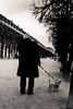 Promenade Commune (LoKee Photo) Tags: lokee lowkey blackandwhite monochrome paris street city urban parisian man dog palais royal silhouette fuji x100s