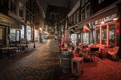 Nightly Service (McQuaide Photography) Tags: haarlem noordholland northholland netherlands nederland holland dutch europe sony a7riii ilce7rm3 7rm3 alpha mirrorless 1635mm sonyzeiss zeiss variotessar fullframe mcquaidephotography lightroom adobe photoshop tripod manfrotto night nacht nightphotography stad city urban lowlight architecture outdoor outside illuminated street straat warmoesstraat window wideangle wideanglelens groothoek building longexposure oldstreet old oud character traditional authentic streetlight atmosphere sfeer winter emptystreet deserted nopeople cobblestone cobbles metzo jacobuspieck restaurant shadow light licht