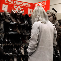 269 of Year 4 - Choices, women at the shoe sale (Hi, I'm Tim Large) Tags: shoe shopping cheap bargin sale reduction girls woman women temptation desaturated colour color boots rack display lines 365 269 fuji fujifilm xf xpro2 23mm f14 rows