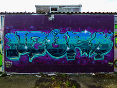 Neuro Quiddled While Rome Burned? (Steve Taylor (Photography)) Tags: neuro btk smeagol arrow art graffiti mural streetart blue mauve purple newzealand nz southisland canterbury christchurch newbrighton star outline