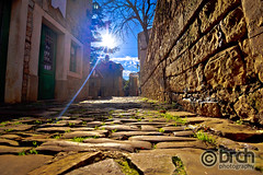 Groznjan cobbled street and old architecture at sunset view (brch1) Tags: groznjan lodge istra istria town heritage site stone rock croatia dalmatian mediterranean village traditional old building wall croatian vegetable adriatic historic green ancient street alley europe homes path road scene tourism way paved walkway grisignana arch gate entrance tourist destination travel cobbled sun sunset haze beam ray istrian