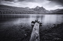 Stanley Lake (Rajesh Jyothiswaran) Tags: elk peak great american solar eclipse idaho light log long exposure mcgowan mountains neutral density filter nisi filters pebbles reflection ridge sawtooth smooth stanley lake trees water zeiss batis 18mm