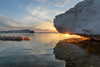 Tribal Waters (Aaron Springer) Tags: michigan northernmichigan lakemichigan thegreatlakes winter ice iceshelf water clouds rock stone sunset sunburst reflections outdoor nature landscape