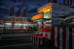 Memories of a Summer Past (Gary Burke.) Tags: foodstall food fun dusk fair empirestatefair architecture attraction longisland nassau uniondale li newyork ilovenewyork summer summerfun creepy goodeats carnival canon eos 70d canoneos70d dslr citylife cityliving travel city urban wanderlust tourism vacation klingon65 traveling garyburke nassaucounty night dark colorful seasonal event gothamist entertainment newyorklife newyorktourism nassaucoliseum sky clouds evening fairgrounds ny carnivaleats vendor foodseller fastfood