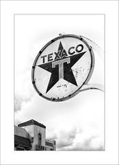 Texaco (DJ Wolfman) Tags: blackandwhite bw texaco oklahoma oklahomacity signs gas station olympus olympusomd olympus714mmf28 micro43 12100mmf4zuiko zd zuiko