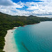 Aerial photo of a breathtaking beach in Grand'Anse Praslin, Seychelles